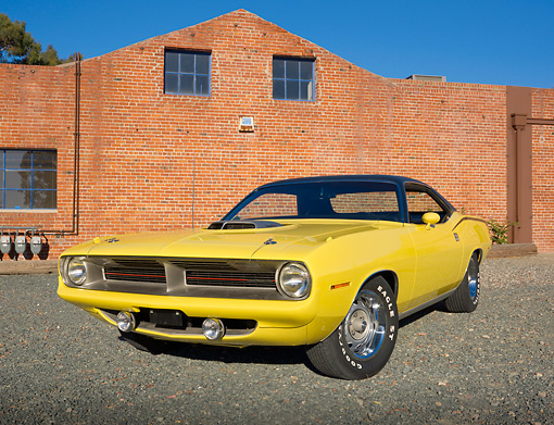 AUT 23 RK2005 01 © Kimball Stock 1970 Plymouth Barracuda 440 Six Pack Yellow 3/4 Front View On Gravel By Brick Building