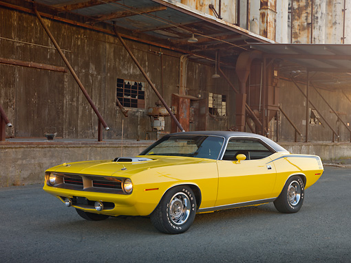 AUT 23 RK2008 01 © Kimball Stock 1970 Plymouth Barracuda 440 Six Pack Yellow 3/4 Front View On Pavement By Old Factory Building