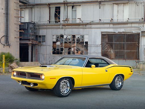 AUT 23 RK2009 01 © Kimball Stock 1970 Plymouth Barracuda 440 Six Pack Yellow 3/4 Front View On Pavement By Old Factory Building