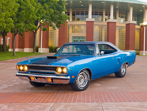 AUT 23 RK2018 01 © Kimball Stock 1970 Plymouth Road Runner Hemi Blue With Black Stripe 3/4 Front View On Pavement By Building