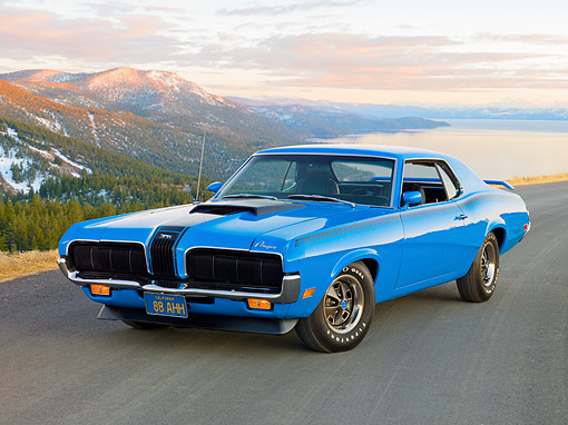 AUT 23 RK2024 01 © Kimball Stock 1970 Mercury Cougar Eliminator Blue 3/4 Front View On Pavement By Forest