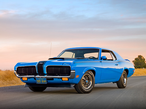 AUT 23 RK2025 01 © Kimball Stock 1970 Mercury Cougar Eliminator Blue 3/4 Front View On Pavement By Dry Grass At Dusk