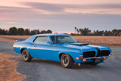 AUT 23 RK2026 01 © Kimball Stock 1970 Mercury Cougar Eliminator Blue 3/4 Front View On Pavement By Dry Grass At Dusk
