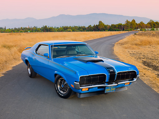 AUT 23 RK2028 01 © Kimball Stock 1970 Mercury Cougar Eliminator Blue 3/4 Front View On Pavement By Dry Grass At Dusk
