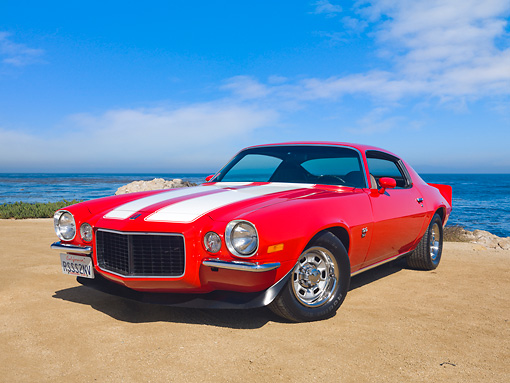 AUT 23 RK2034 01 © Kimball Stock 1972 Chevrolet Camaro RS/SS Red With White Stripes 3/4 Front View On Sand By Ocean