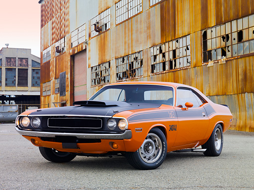 AUT 23 RK2040 01 © Kimball Stock 1970 Dodge Challenger T/A Orange And Black 3/4 Front View On Pavement By Old Building