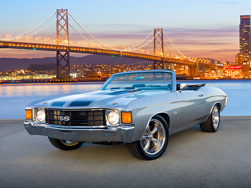 AUT 23 RK2092 01 © Kimball Stock 1972 Chevrolet Chevelle Silver With Black Stripe 3/4 Front View On Pavement By San Francisco Bay Bridge