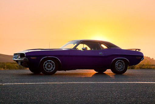 AUT 23 RK2106 01 © Kimball Stock 1970 Dodge Challenger RT 440 Purple Profile View On Road At Sunset