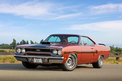 AUT 23 RK2110 01 © Kimball Stock 1970 Plymouth GTX Burnt Orange With Black Stripe 3/4 Front View On Pavement By Fence