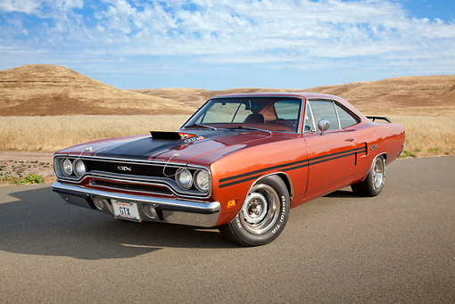 AUT 23 RK2115 01 © Kimball Stock 1970 Plymouth GTX Burnt Orange With Black Stripe 3/4 Front View On Pavement By Dry Grass