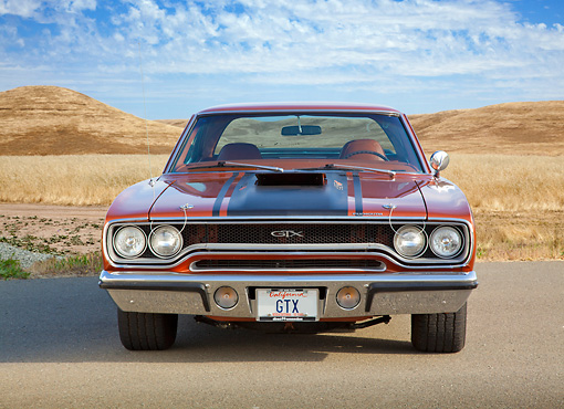 AUT 23 RK2117 01 © Kimball Stock 1970 Plymouth GTX Burnt Orange With Black Stripe Front View On Pavement By Dry Grass