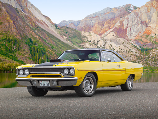 AUT 23 RK2145 01 © Kimball Stock 1970 Plymouth Road Runner 440 Six Pac Yellow With Black Stripe 3/4 Front View On Pavement By Mountains And Water