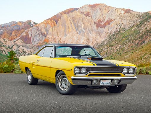 AUT 23 RK2154 01 © Kimball Stock 1970 Plymouth Road Runner 440 Six Pac Yellow With Black Stripe 3/4 Front View On Pavement By Mountains