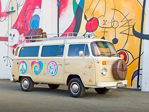 AUT 23 RK2156 01 © Kimball Stock 1974 Volkswagen Type 2 Tan With Hippie Logos 3/4 Side View On Pavement By Mural