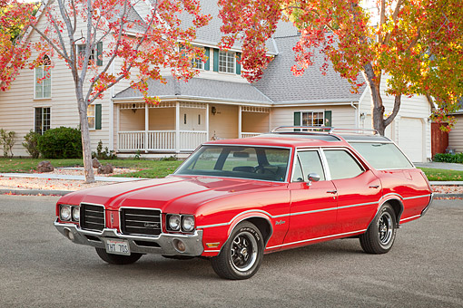 AUT 23 RK2165 01 © Kimball Stock 1971 Oldsmobile Vista Cruiser Red 3/4 Front View On Pavement By House And Autumn Trees