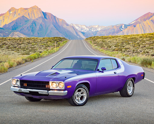AUT 23 RK2172 01 © Kimball Stock 1973 Plymouth Road Runner Purple 3/4 Front View On Road By Mountains