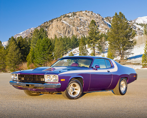 AUT 23 RK2174 01 © Kimball Stock 1973 Plymouth Road Runner Purple 3/4 Front View On Pavement By Snowy Mountains