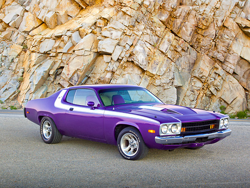 AUT 23 RK2177 01 © Kimball Stock 1973 Plymouth Road Runner Purple 3/4 Front View On Pavement By Rocky Cliffside