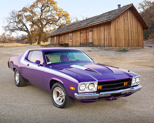 AUT 23 RK2178 01 © Kimball Stock 1973 Plymouth Road Runner Purple 3/4 Front View On Gravel By Barn