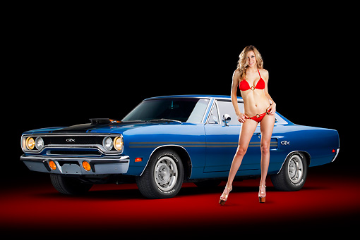 AUT 23 RK2191 01 © Kimball Stock 1970 Plymouth GTX Blue 3/4 Front View In Studio With Swimsuit Model