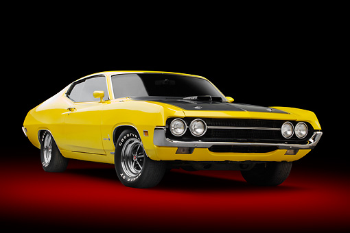 AUT 23 RK3383 01 © Kimball Stock 1970 Ford Torino 429 Super Cobra Jet Yellow 3/4 Front View In Studio