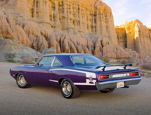 AUT 23 RK3389 01 © Kimball Stock 1970 Dodge Super Bee Purple 3/4 Rear View On Gravel By Cliffs