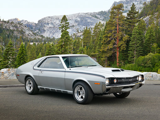 AUT 23 RK3398 01 © Kimball Stock 1970 AMC AMX Silver And Black 3/4 Front View On Pavement By Mountains And Trees