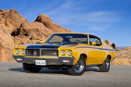AUT 23 RK3406 01 © Kimball Stock 1970 Buick GSX Saturn Yellow And Black 3/4 Front View On Pavement By Boulders