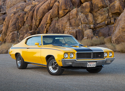 AUT 23 RK3407 01 © Kimball Stock 1970 Buick GSX Saturn Yellow And Black 3/4 Front View On Pavement By Rock Wall