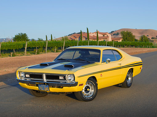 AUT 23 RK3427 01 © Kimball Stock 1971 Dodge Demon Yellow With Black Stripes 3/4 Front View On Pavement By Vineyard