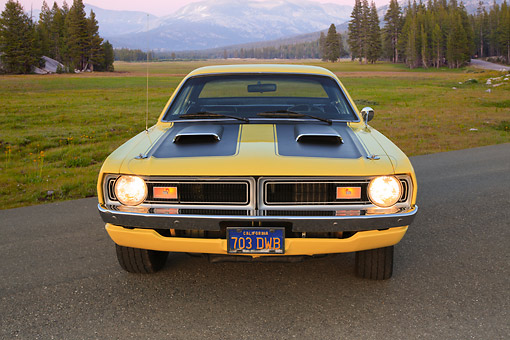 AUT 23 RK3430 01 © Kimball Stock 1971 Dodge Demon Yellow With Black Stripes Front View On Pavement By Field And Mountains