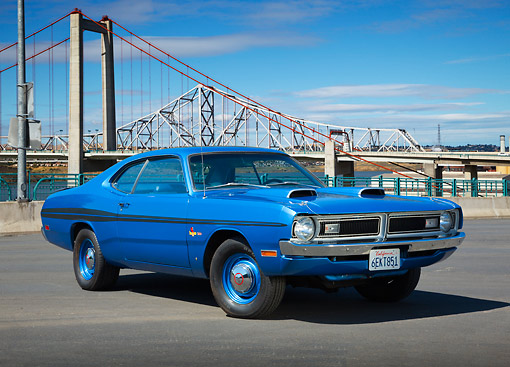 AUT 23 RK3435 01 © Kimball Stock 1971 Dodge Demon Blue 3/4 Front View On Pavement By Bridge