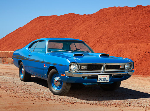 AUT 23 RK3436 01 © Kimball Stock 1971 Dodge Demon Blue 3/4 Front View On Gravel By Red Dirt Pile