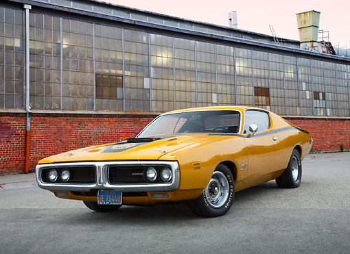 AUT 23 RK3439 01 © Kimball Stock 1971 Dodge Charger 440 Six Pac Butterscotch 3/4 Front View On Pavement By Brick Building