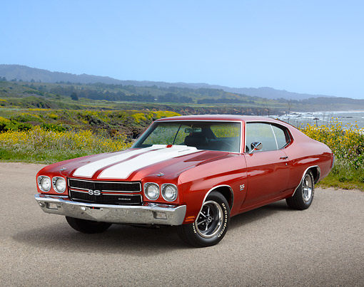 AUT 23 RK3440 01 © Kimball Stock 1970 Chevrolet Chevelle SS Amber With White Stripes 3/4 Front View On Pavement By Beach