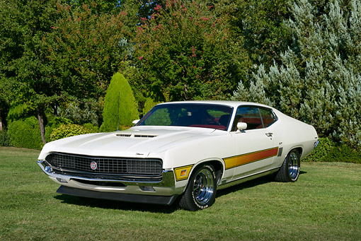 AUT 23 RK3444 01 © Kimball Stock 1970 Ford Torino GT Wimbledon White 3/4 Front View On Grass By Trees