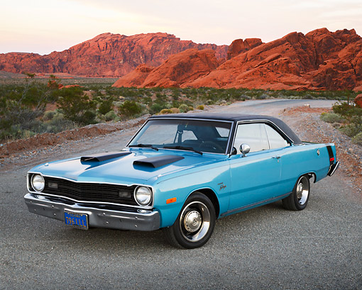 AUT 23 RK3445 01 © Kimball Stock 1974 Dodge Dart Swinger Blue 3/4 Front View On Gravel In Desert