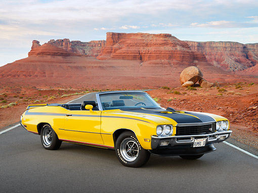 AUT 23 RK3451 01 © Kimball Stock 1971 Buick GSX Convertible Yellow 3/4 Front View On Road In Desert