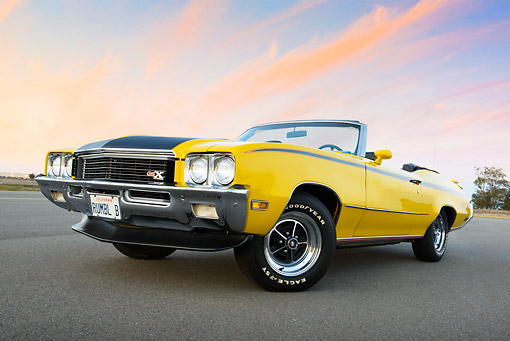 AUT 23 RK3452 01 © Kimball Stock 1971 Buick GSX Convertible Yellow 3/4 Front View On Pavement At Dusk