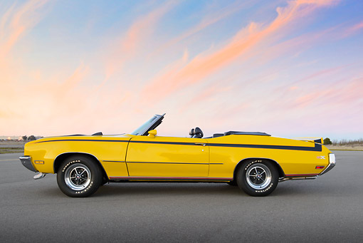 AUT 23 RK3453 01 © Kimball Stock 1971 Buick GSX Convertible Yellow Profile View On Pavement At Dusk