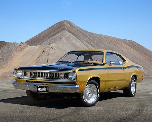 AUT 23 RK3457 01 © Kimball Stock 1971 Plymouth Duster Gold With Black Stripes 3/4 Front View On Pavement By Pile Of Gravel