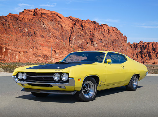 AUT 23 RK3471 01 © Kimball Stock 1970 Ford Torino 429 Cobra Jet Ram Air Yellow And Black 3/4 Front View On Pavement In Desert
