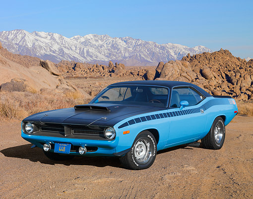 AUT 23 RK3478 01 © Kimball Stock 1970 Plymouth AAR Cuda Blue 3/4 Front View On Gravel By Mountains