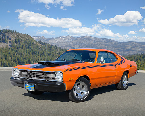 AUT 23 RK3480 01 © Kimball Stock 1975 Dodge Dart Sport Orange And Black 3/4 Front View On Pavement By Mountains