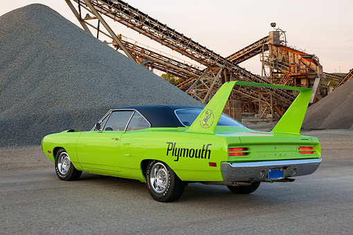 AUT 23 RK3485 01 © Kimball Stock 1970 Plymouth Hemi Superbird Lime Green 3/4 Rear View On Pavement By Gravel Piles