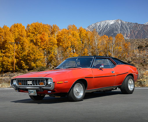 AUT 23 RK3495 01 © Kimball Stock 1973 AMC Javelin Orange 3/4 Front View On Pavement By Autumn Trees