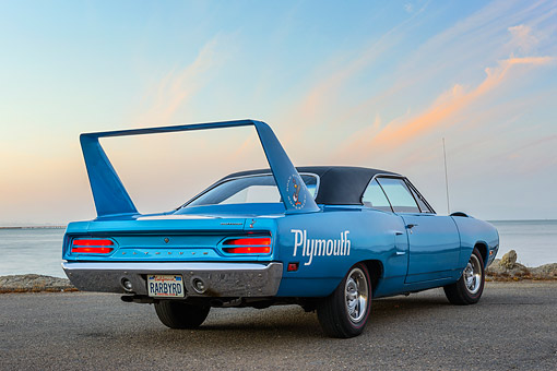 AUT 23 RK3498 01 © Kimball Stock 1970 Plymouth Superbird 400 Six Pac Blue 3/4 Rear View On Pavement By Water At Dusk