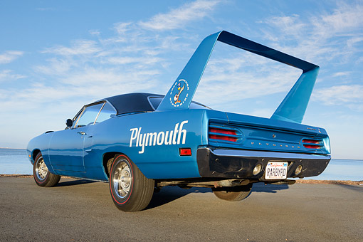 AUT 23 RK3499 01 © Kimball Stock 1970 Plymouth Superbird 400 Six Pac Blue 3/4 Rear View On Pavement By Water
