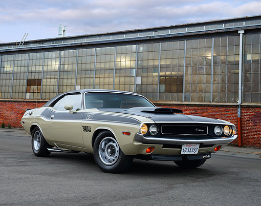 AUT 23 RK3506 01 © Kimball Stock 1970 Dodge Challenger T/A 340 Six Pak Beige And Black 3/4 Front View On Pavement By Old Factory Building