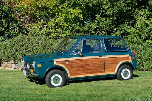 AUT 23 RK3507 01 © Kimball Stock 1971 Honda N600 Custom Woodie Green 3/4 Side View On Grass By Trees